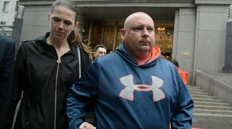 Former NYPD Officer Robert Espinel, right, exits a