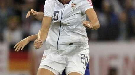 United States' Abby Wambach jumps for the ball