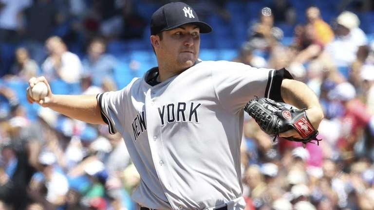New York Yankees pitcher Phil Hughes works against