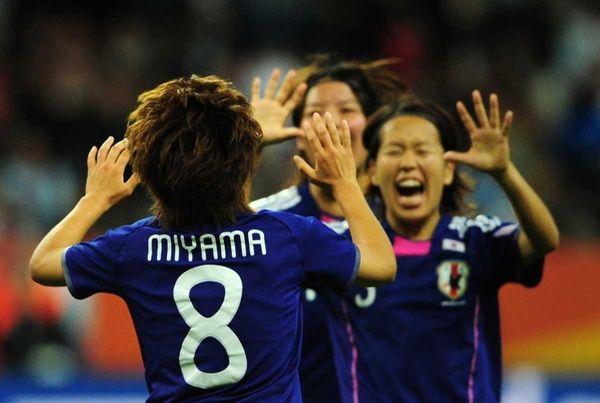 Japan's midfielder Aya Miyama celebrates with her teammates