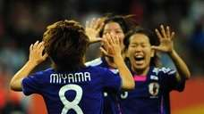 Japan's midfielder Aya Miyama celebrates with her teammates