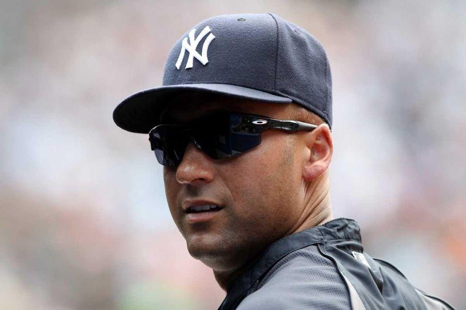 New York Yankees' Derek Jeter stands outside the