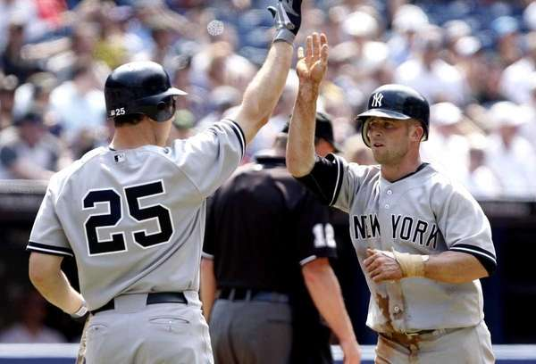 Mark Teixeira celebrates with Brett Gardner of the