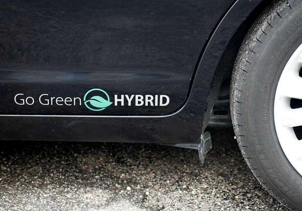 A hybrid decal on a Ford Fusion hybrid