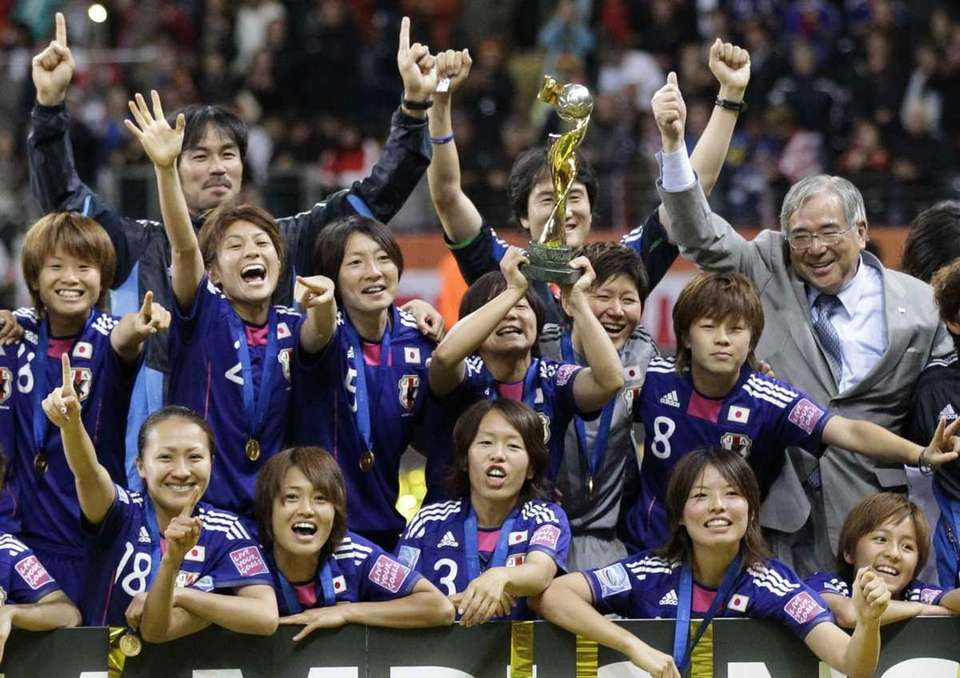Japanese players celebrate with the trophy after winning