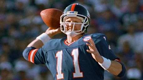 Giants quarterback Phil Simms winds up to pass
