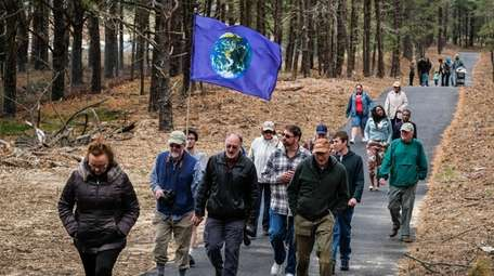 Environmental advocates and residents walk the newly paved
