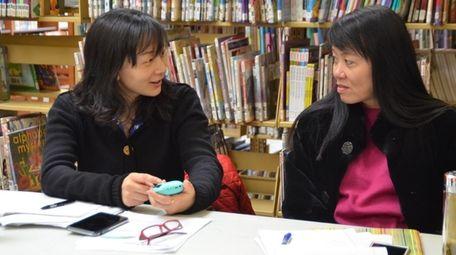 Ling Ling Zhu, left, and Yafen Zhou help