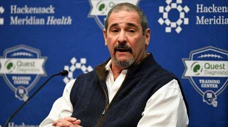 Giants GM Dave Gettleman speaks to reporters during