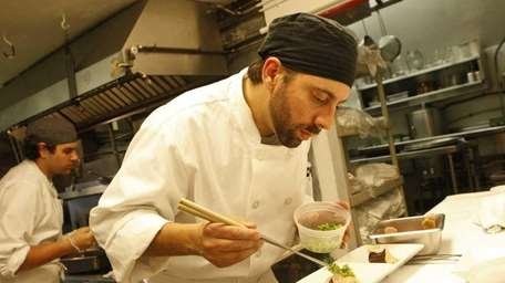 Co-chef and owner Adam Kopels of 18 Bay