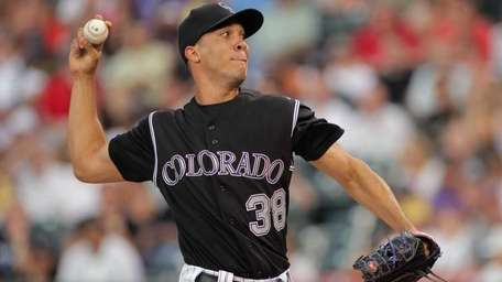 Ubaldo Jimenez of the Colorado Rockies delivers against