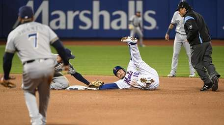 Milwaukee Brewers second baseman Mike Moustakas tags out