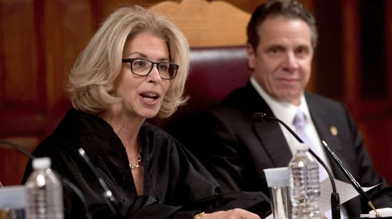 Chief Judge Janet DiFiore, left, speaks at the