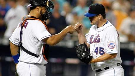 New York Mets' Ronny Paulino #9 congratulates Jason
