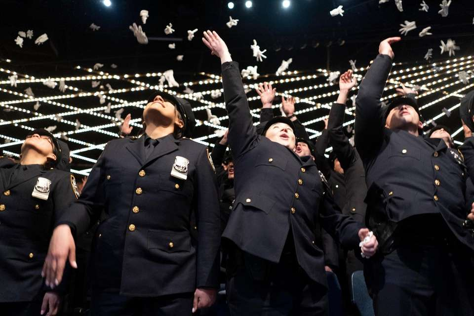 Members of the NYPD graduating class of celebrate