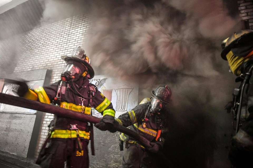 Volunteer firefighters from the Oceanside Fire Department train