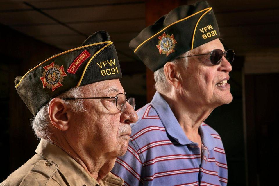 VFW members Mario Obertis, 85, left, of New