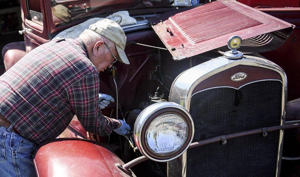 Roger F. Clark, 82, of Hauppauge, works on