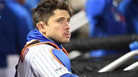Mets catcher Travis d'Arnaud looks on from the