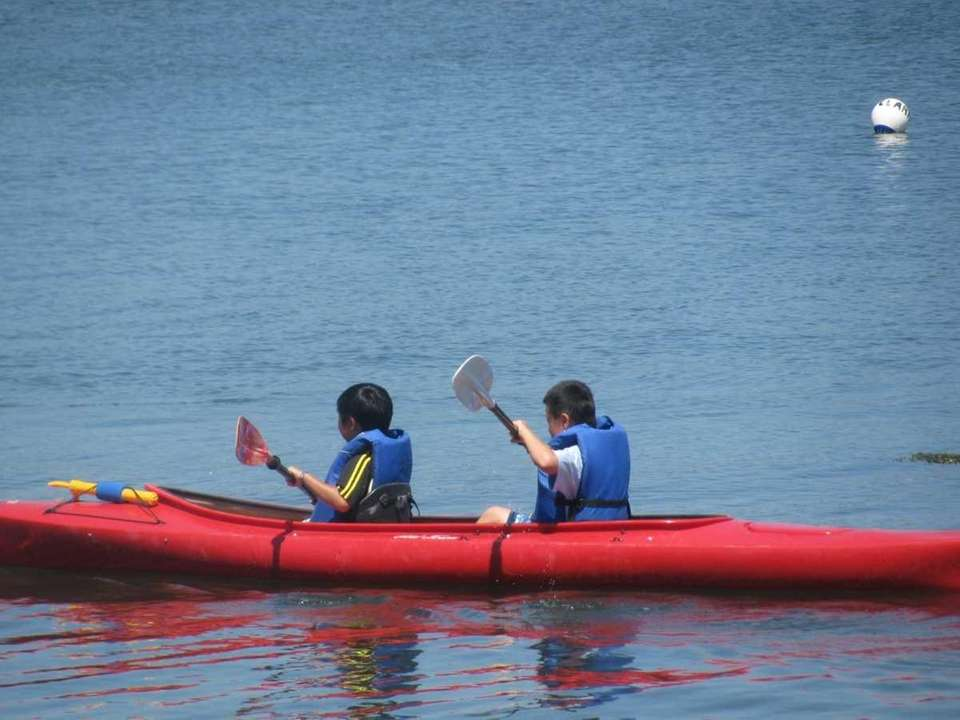 Pictured above are two kayakers exploring the shoreline