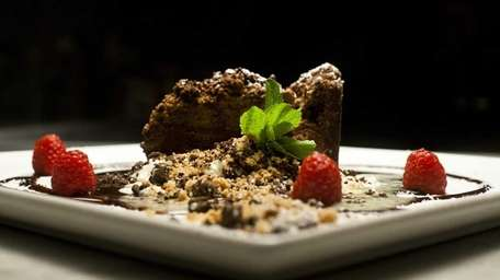A chocolate cappuccino cake is served at The