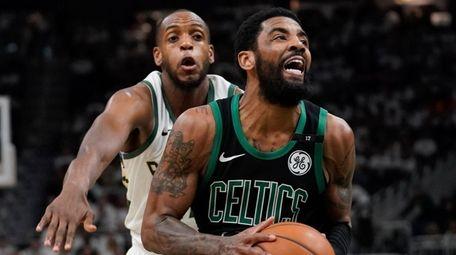 Boston Celtics' Kyrie Irving drives past the Milwaukee