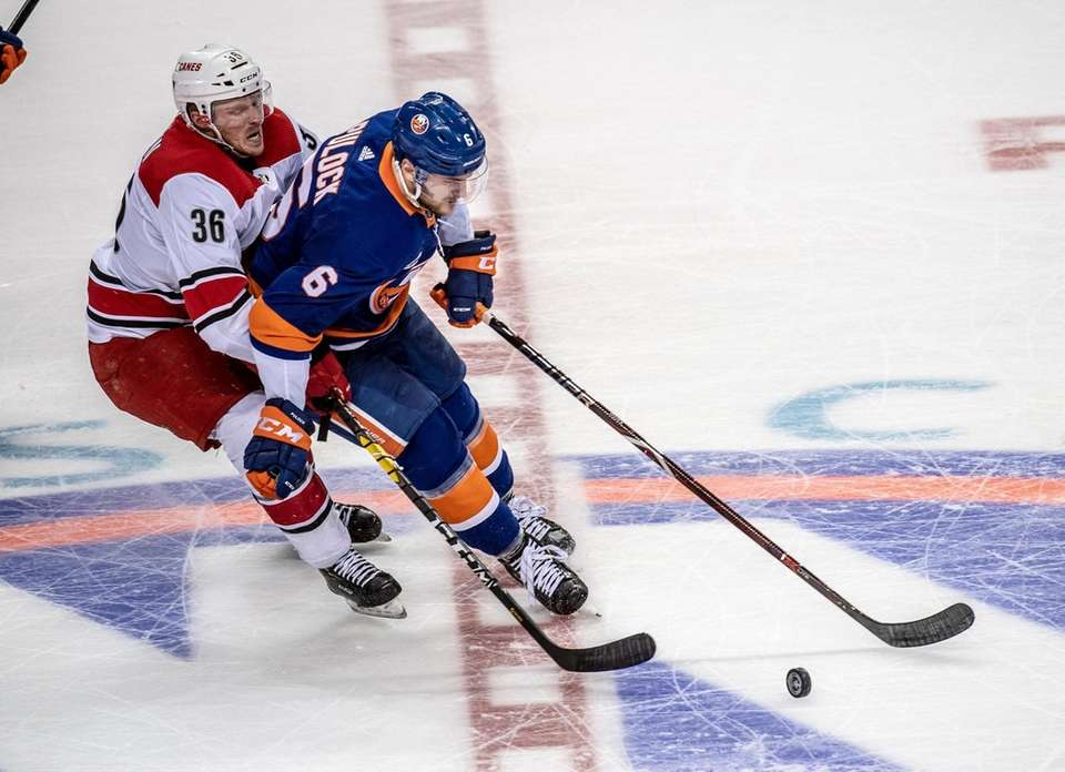 New York Islanders' Ryan Pulock getting pressure from