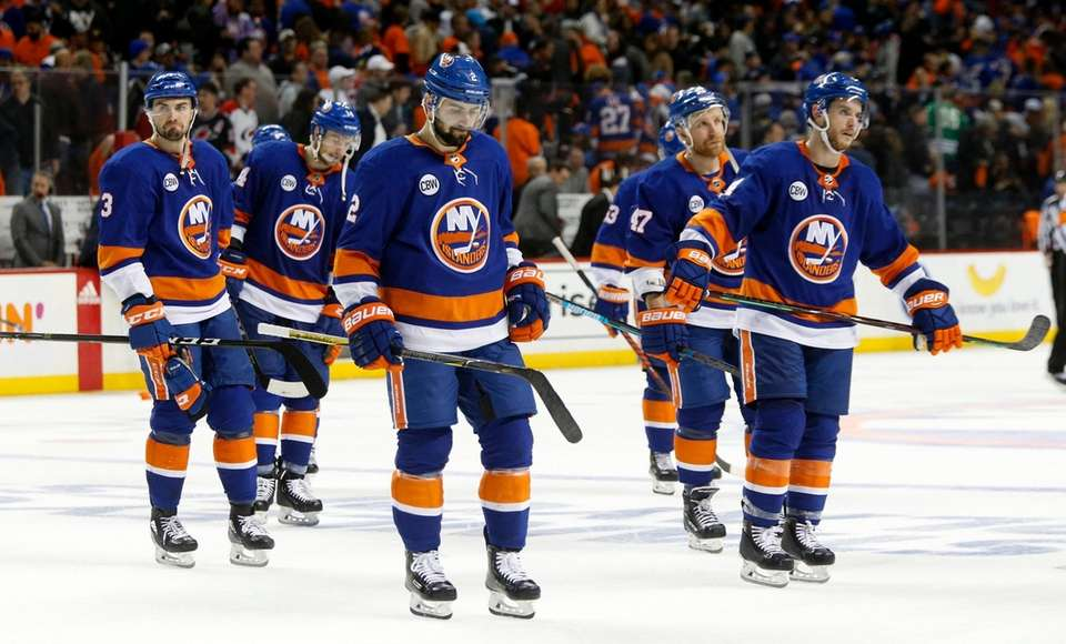 The Islanders skate off the ice after Game