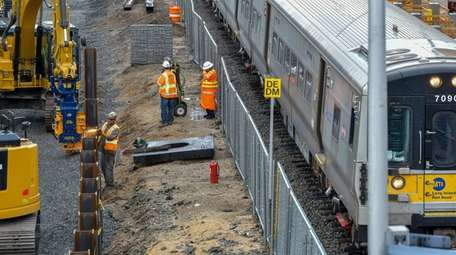 Crews work on the Third Track project at