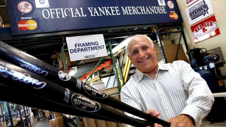 Brandon Steiner, CEO of Steiner Sports, swings Derek