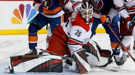 Curtis McElhinney #35 of the Carolina Hurricanes makes