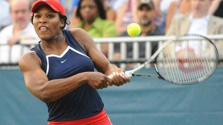 Serena Williams of the Washington Kastles returns a