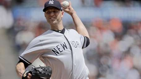 Yankees pitcher J.A. Happ works against the San