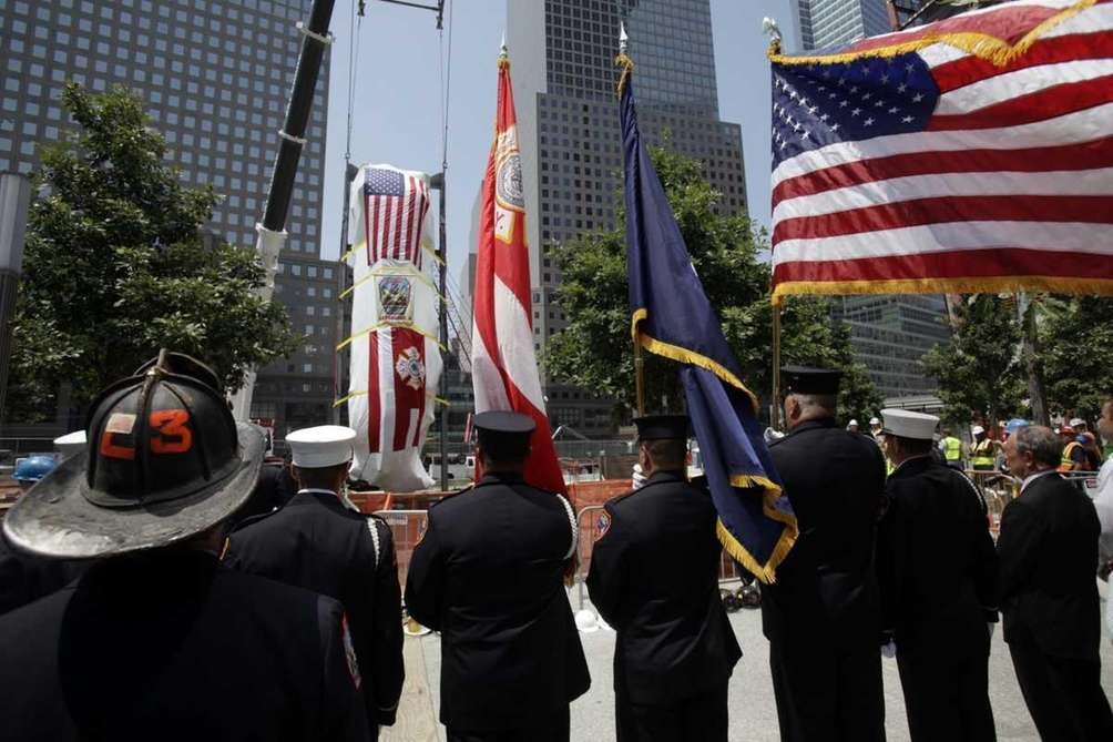 Firefighters and other dignitaries watch as the FDNY's