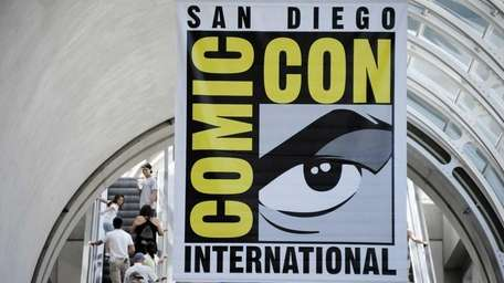 Fans arrive during preview night at the Comic-Con