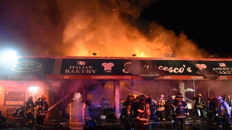 Firefighters at Francesco's Bakery in Hicksville on Sunday