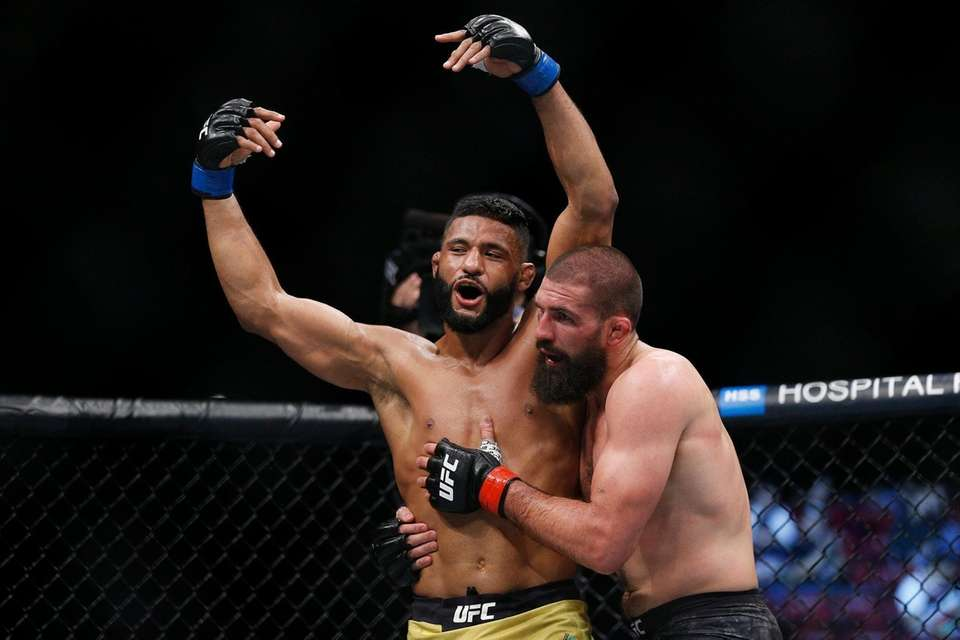 Dhiego Lima of Brazil and Court McGee react