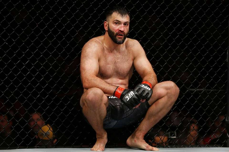 Andrei Arlovski of Belarus reacts after losing to