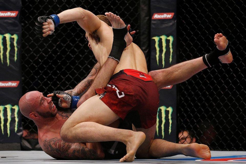 Takashi Sato of Japan punches Ben Saunders as