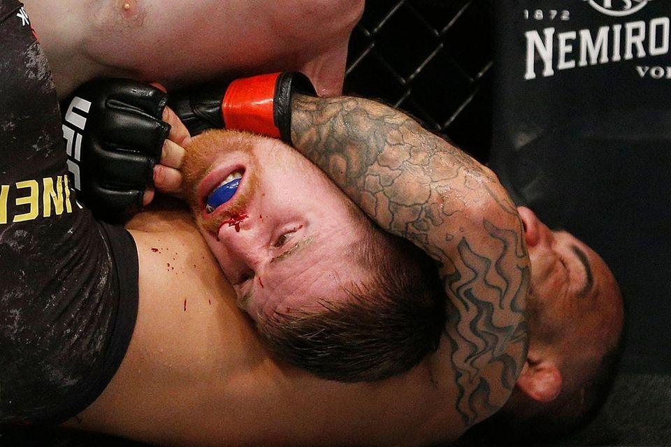 John Lineker fights Cory Sandhagen during their bantamweight