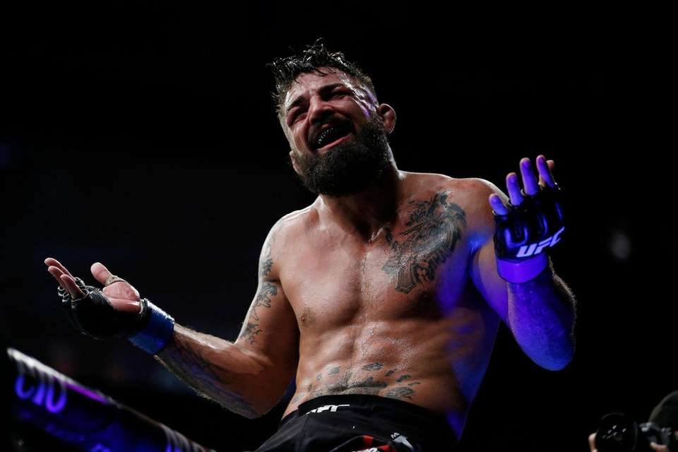 Mike Perry celebrates after defeating Alex Oliveira of