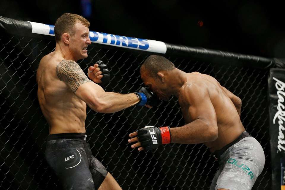 Jack Hermansson of Sweden punches Ronaldo Souza of