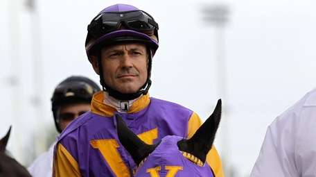 Jon Court, riding Archarcharch, is escourted onto the