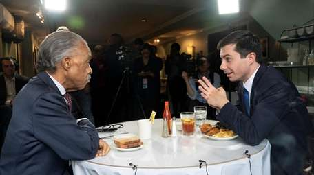 Democratic presidential candidate Pete Buttigieg, right, speaks with