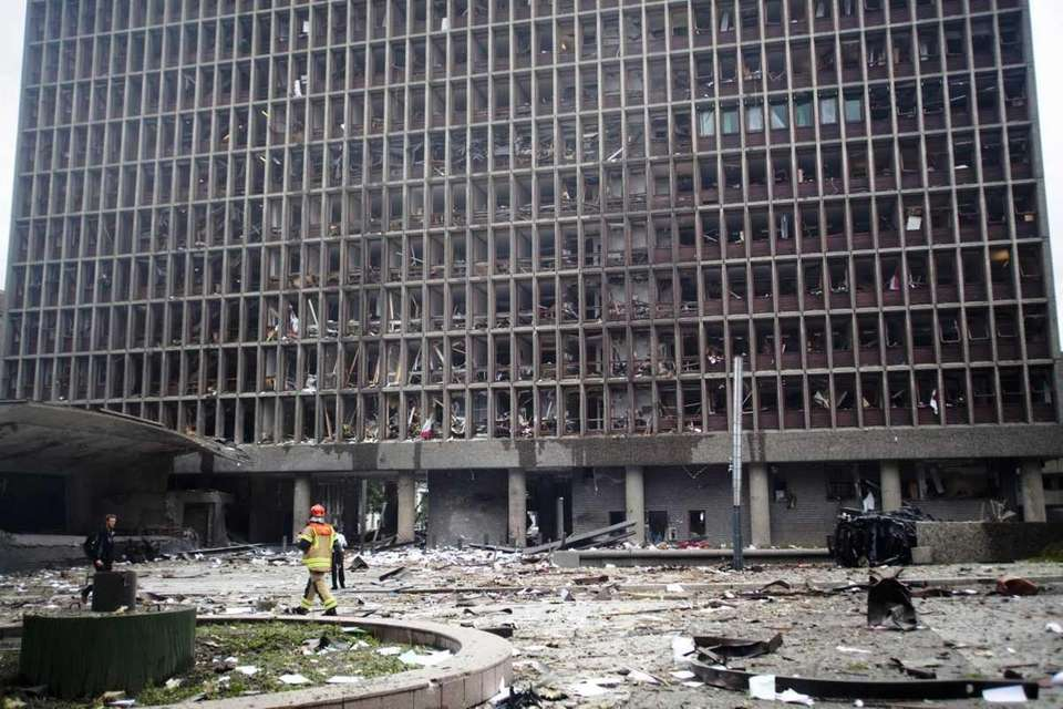 Debris covers the area outside a building in
