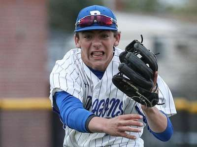 Nick Roselli of Division makes the throw to