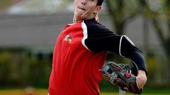 Hills East's starting pitcher Steve Mariani (20) during