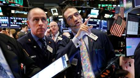 Traders Michael Urkonis, left, and Gregory Rowe work