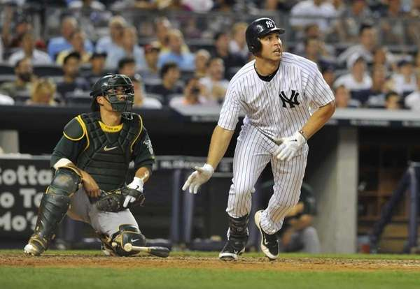 Mark Teixeira watches the ball as it leaves
