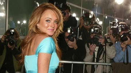 LI's Lindsay Lohan arrives for the premiere of